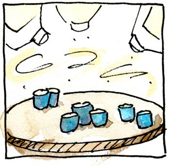 Baijiu bottles pouring into cups