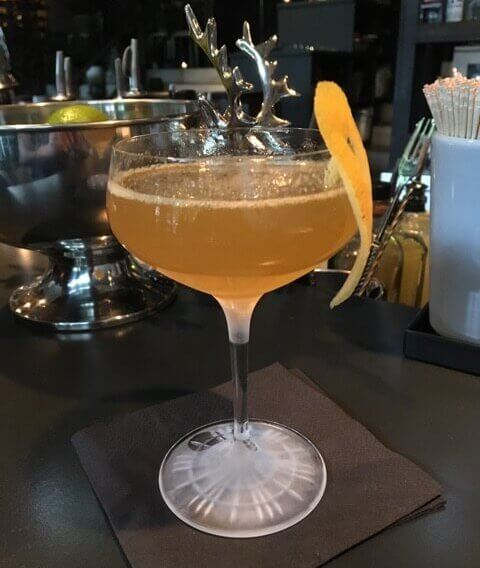 Baijiu cocktail with citrus peel