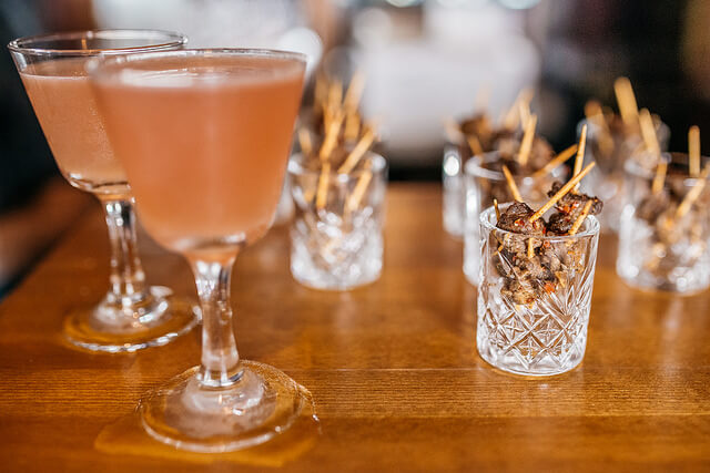 Pink baijiu cocktails and beef skewers