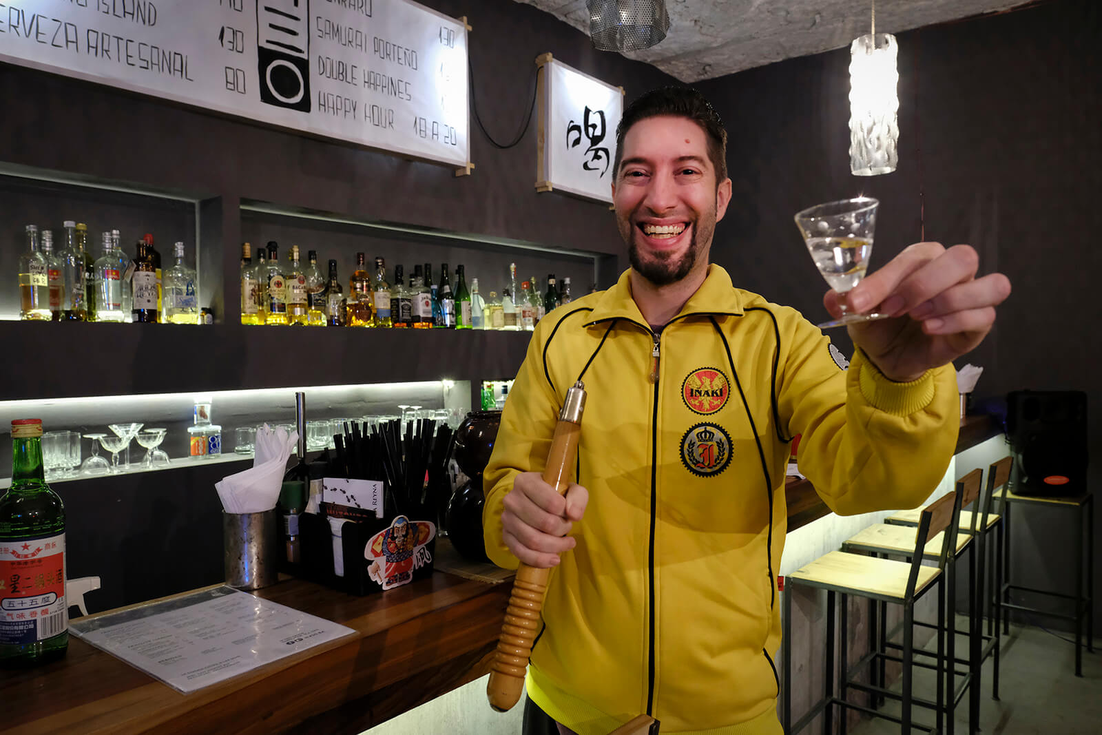 Bartender toasting with baijiu