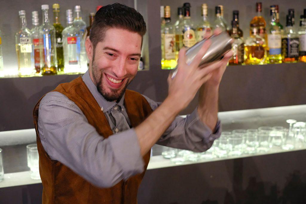 Bartender mixes baijiu cocktail