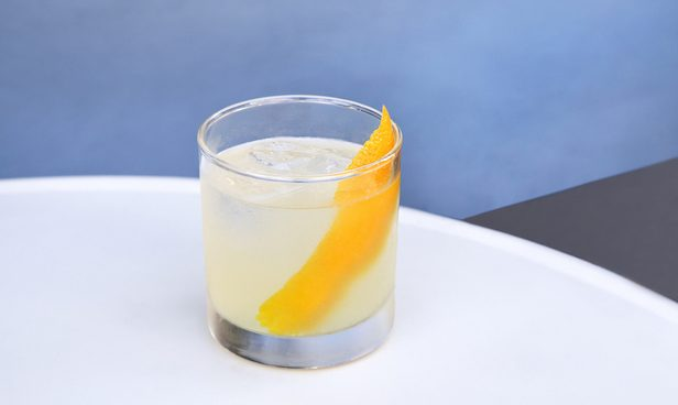 Baijiu cocktail with orange peel