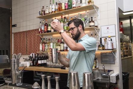 Bartender pours baijiu into shaker