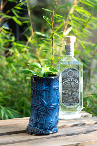Baijiu cocktail in blue tiki mug