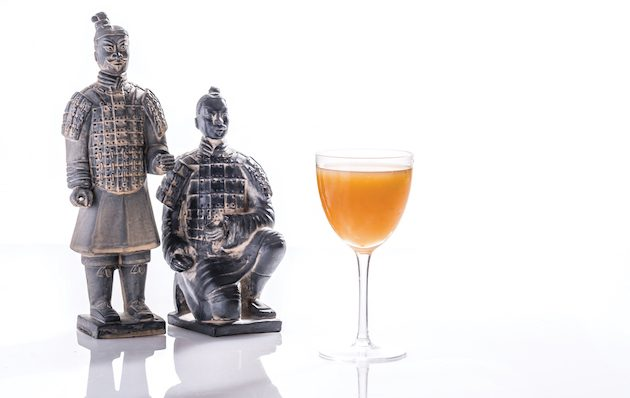 Orange baijiu cocktail with terracotta warriors