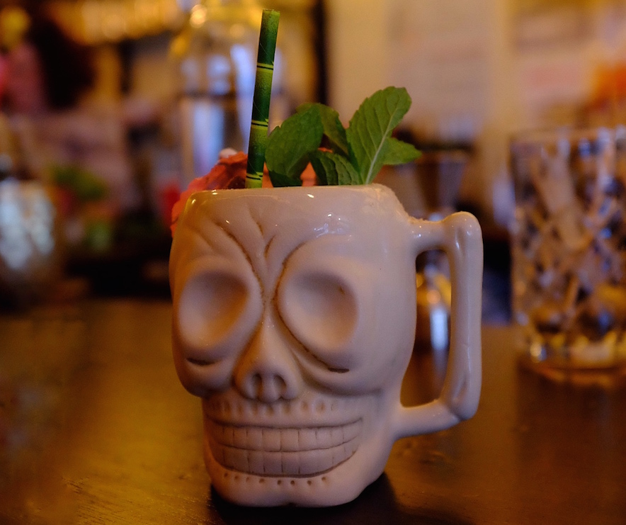 Baijiu cocktail in skull tiki mug