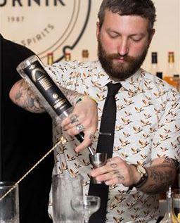 Bartender pouring into jigger