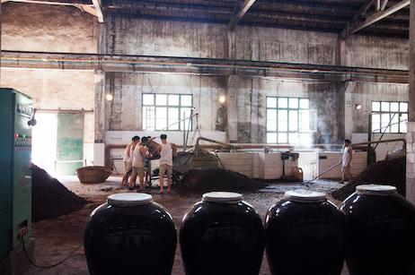 Workers at a baijiu production facility