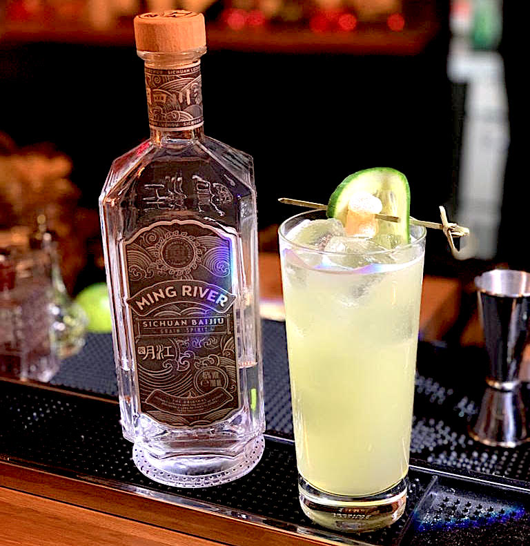 yellow baijiu cocktail and bottle