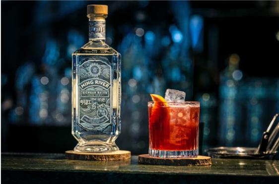 red baijiu lowball with bottle